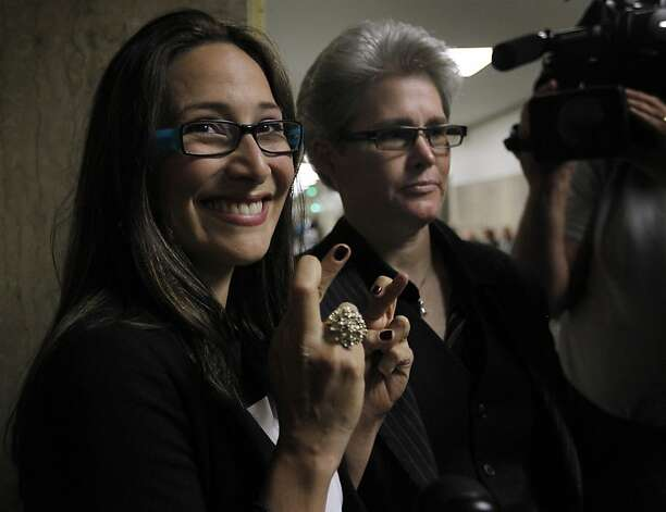 Eliana Lopez crosses her fingers before Judge Garrett Wong lifted the stay-away order at the Hall of Justice in San Francisco, Calif. on Friday, July 20, 2012, that will allow Lopez to see her husband, suspended sheriff Ross Mirkarimi. Photo: Paul Chinn, The Chronicle