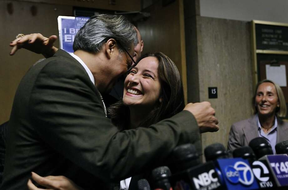 Suspended Sheriff Ross Mirkarimi hugs his wife Eliana Lopez after Judge Garrett Wong lifted the stay-away order that prevented them from having any contact, at the Hall of Justice in San Francisco, Calif. on Friday, July 20, 2012. Watching in the background is Lopez's atorney Paula Canny. Photo: Paul Chinn, The Chronicle
