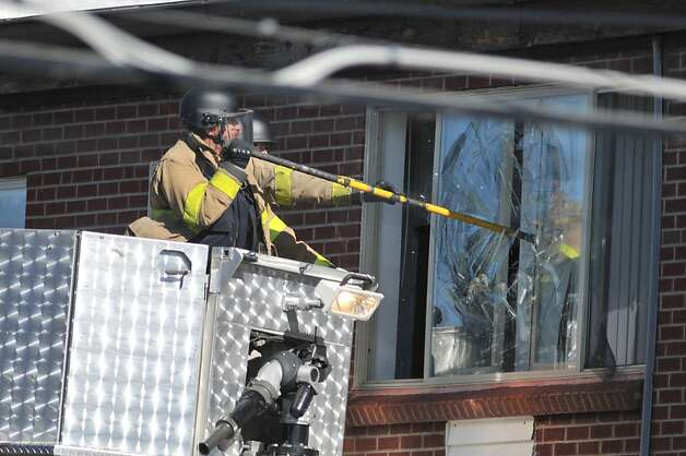 "AURORA, CO - JULY 20:  Police break the window of the apartment of of James Holmes, the suspect of a shooting in a movie theater July 20, 2012 in Aurora, outside of Denver, Colorado. According to reports, 12 people have been killed and 59 wounded when James allegedly opened fire inside the a movie theater showing the ""The Dark Knight Rises.""  Police have James, 24, of Holmes of North Aurora, in custody.  (Photo by Thomas Cooper/Getty Images) Photo: Thomas Cooper, Getty Images"