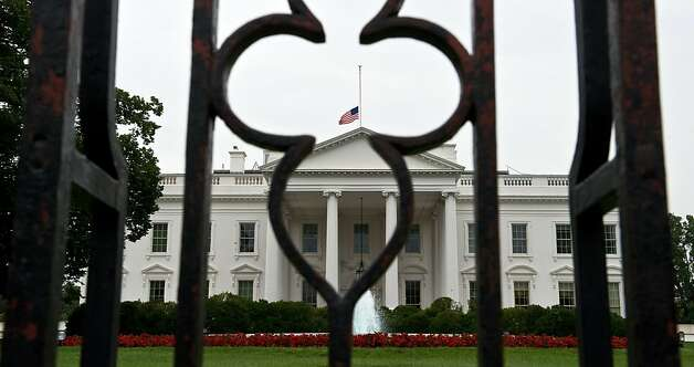 Tthe flag flies at half-mast at the White House in Washington,DC on July 20, 2012 after the shocking shooting at a Colorado movie theater that left 12 people dead and over 50 injured.  US President Obama on Friday ordered US flags to be flown at half-mast for six days to honor the victims of the deadly shooting at the premiere of a Batman movie in Colorado. AFP PHOTO/Nicholas KAMMNICHOLAS KAMM/AFP/GettyImages Photo: Nicholas Kamm, AFP/Getty Images