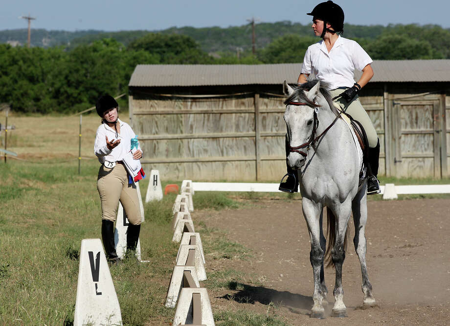 Donny Kinney (left) coaches Christiana Earle at the Alamo Dressage Summer Schooling Show last month. Presidential candidate Mitt Romney's wife Ann has increased interest in the sport. Photo: Jerry Lara, San Antonio Express-News / © 2012 San Antonio Express-News
