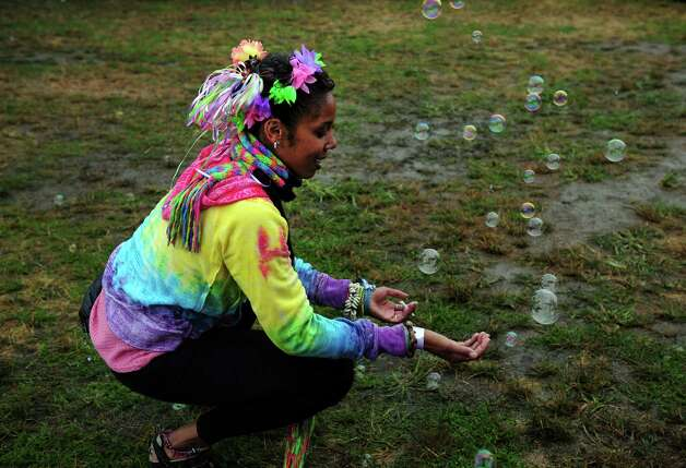 Raelynn Merritt, of New Britain, chases bubbles during the Gathering of the Vibes at Seaside Park in Bridgeport, Conn. Friday, July 20, 2012. Photo: Autumn Driscoll / Connecticut Post freelance
