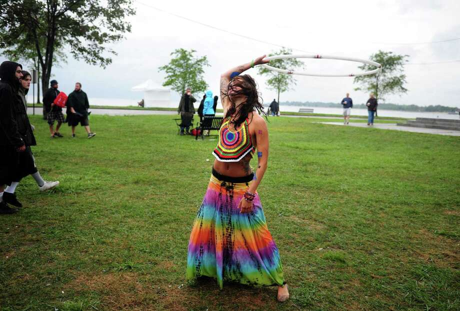 Katie Egan, of Newport, RI, sways to the music during the Gathering of the Vibes at Seaside Park in Bridgeport, Conn. Friday, July 20, 2012. Photo: Autumn Driscoll / Connecticut Post freelance