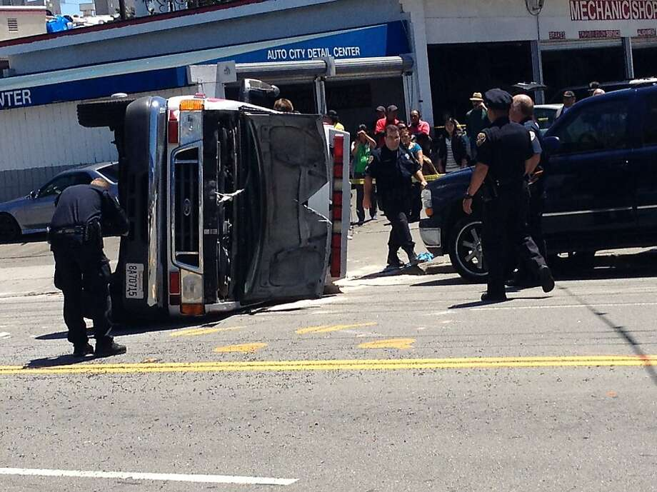 Four people were injures when an ambulance collided with a car at the intersection of 16th Street and South Van Ness Avenue in San Francisco on Friday, July 20, 2012. Photo: Vivian Ho, The Chronicle