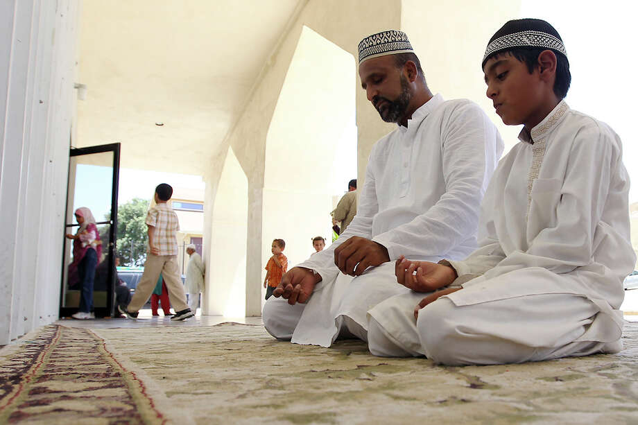 Syed Ahmed and his nine-year-old son, Shafay Syed, observe Ramadan at the Islamic Center of San Antonio on Friday, July 20, 2012. The center serves the largest gathering of Muslims in San Antonio according to their website. Muslims observe Ramadan with fasting from dawn to dusk and typically avoid drinking and eating during the specified time. Ramadan is observed for 30 days. Photo: Kin Man Hui, SAN ANTONIO EXPRESS-NEWS / ©2012 San Antonio Express-News