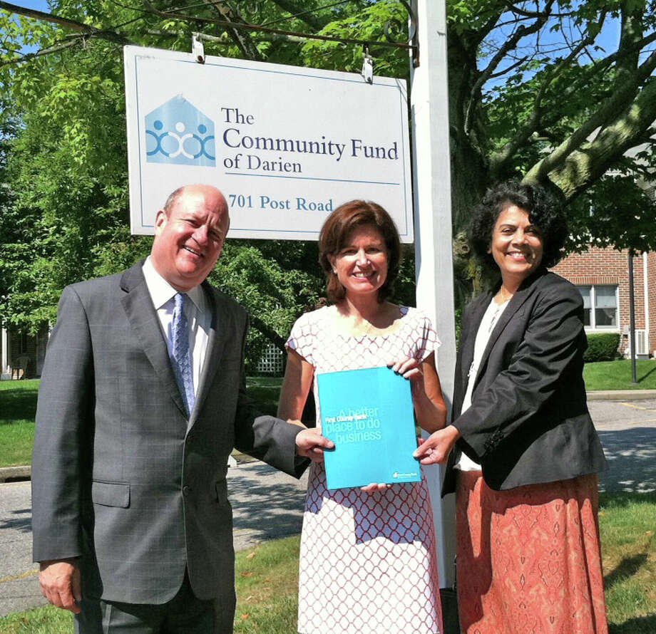Above, Mark Rosenbloom and Prabhat Jadhav of First County Bank with Jenny Streeter, executive director of The Community Fund of Darien (middle), July 18, 2012. Photo: Contributed Photo