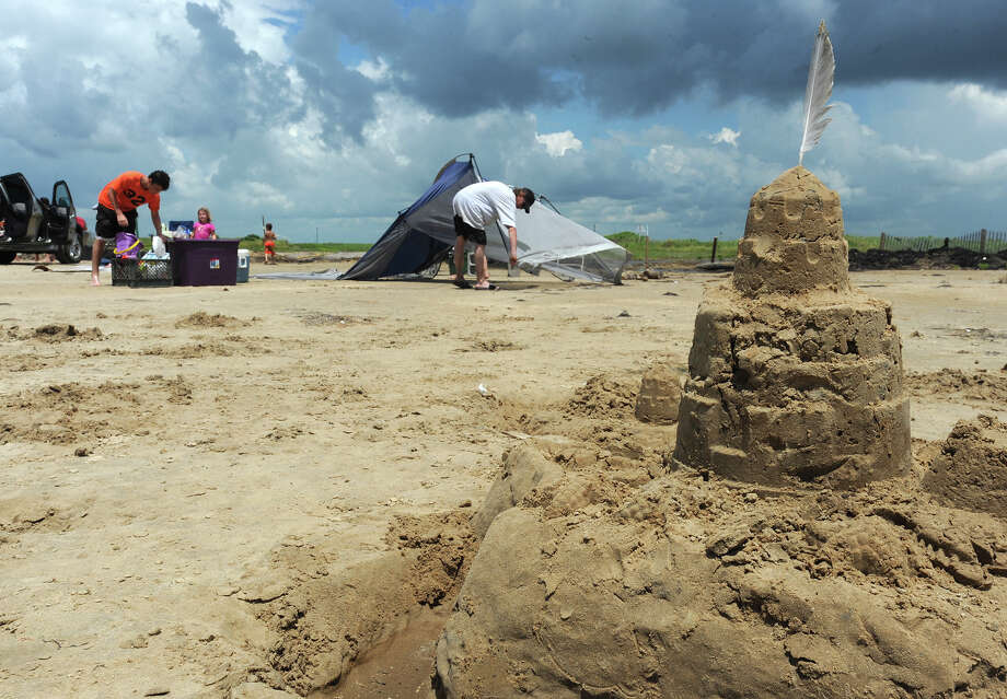 Chad Hurley disassembles a tent at Sea Rim State Park on Thursday. Hurley and a small group spent two days in the area saying they enjoyed the beach, but had to stay in a local motel to avoid mosquitos. Photo taken Thursday, July 19, 2012 Guiseppe Barranco/The Enterprise Photo: Guiseppe Barranco, STAFF PHOTOGRAPHER / The Beaumont Enterprise