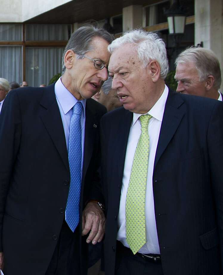Spanish Foreign Minister Jose Manuel Garcia-Margallo (R) speaks with Italian Foreign Minister Giulio Terzi di Sant Agata during the Fourth Session of the reflection group on the future of Europe, in Palma de Mallorca, on July 20, 2012. AFP PHOTO / Jaime REINAJAIME REINA/AFP/GettyImages Photo: Jaime Reina, AFP/Getty Images