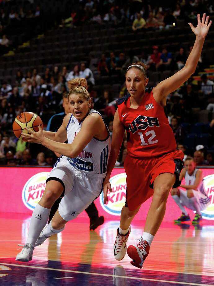 MANCHESTER, ENGLAND - JULY 18: Jo Leedham (L) of Standard Life Team Great Britain in action with Diana Taurasi of the USA Women, during the match between Standard Life Team Great Britain andUSA Women, at the MEN Arena on July 18, 2012 in Manchester, England. (Photo by Paul Thomas/Getty Images) Photo: Paul Thomas, Getty Images / 2012 Getty Images