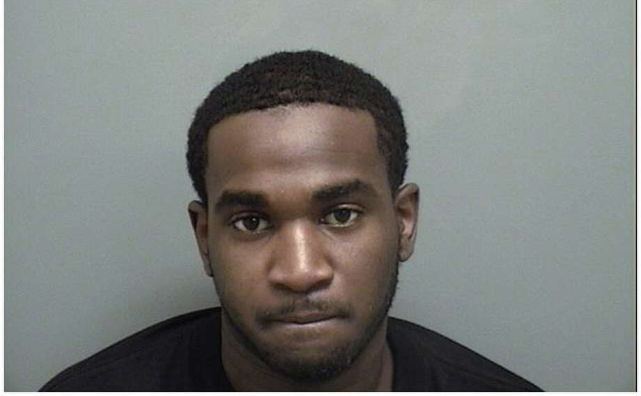 Stanley Alexander, 23, of Brooklyn, N.Y., is facing multiple charges after police said he tried to pass a counterfeit $100 bill at a Darien liquor store July 19, 2012. Photo: Contributed Photo