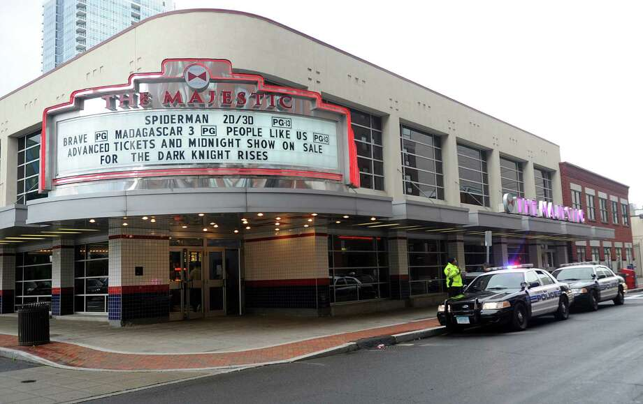 Stamford police officers patrol outside the Majestic Theater downtown on Friday, July 20, to provide an increased presence after the shooting in Aurora, Colo., during a Friday midnight premier of Batman. Photo: Lindsay Niegelberg / Stamford Advocate