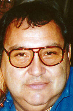 John Florez, a West Side philanthropist, was beaten to death in his video store Friday. Police on Friday arrested an 18-year-old homeless man in the killing. Photo: FAMILY PHOTO / FLOREZ FAMILY