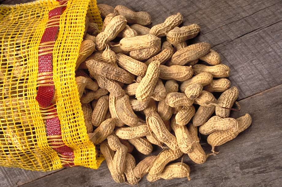 This undated file photo released by the U.S. Department of Agriculture shows a bag of peanuts. Sussing out hidden peanuts is old hat to people living with food allergies. The state of Texas is now requiring public schools and open-enrollment charter schools to implement strategies for special care of students with food allergies. Photo: File Photo / U.S. DEPT. OF AGRICULTURE