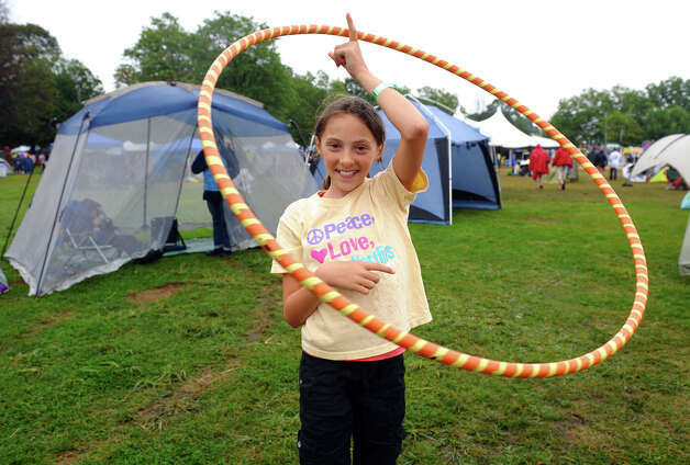 Emory Ciocci, 10, of Stamford, twirls a hoola hoop while at the Gathering of the Vibes concert at Seaside Park in Bridgeport, Conn. on Friday July 20, 2012. Photo: Christian Abraham / Connecticut Post freelance