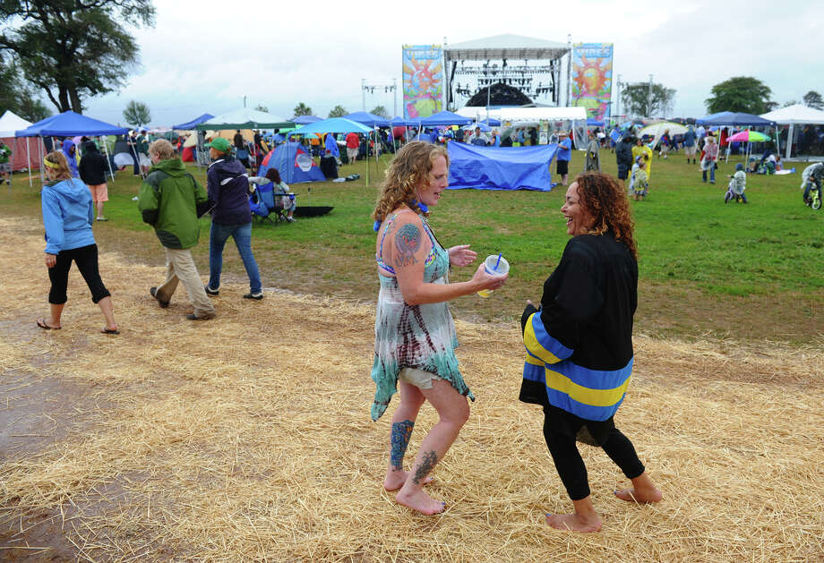Suzanne White and Terri Goodison, both from Binghamton, NY, dance while at the Gathering of the Vibes concert at Seaside Park in Bridgeport, Conn. on Friday July 20, 2012. Photo: Christian Abraham / Connecticut Post freelance