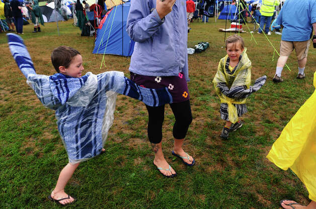 Brandyn Malichek, 5, at left, of Long Island, and Holdden Csajko, 4, of Charleston, SC, play while at the Gathering of the Vibes concert at Seaside Park in Bridgeport, Conn. on Friday July 20, 2012. Photo: Christian Abraham / Connecticut Post freelance