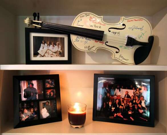 A violin, signed by caste members of a play, on a shelf in the dinning room in the home of Eric Geyer on W. Ridgewood.  Thursday, July 19, 2012. (San Antonio Express-News)