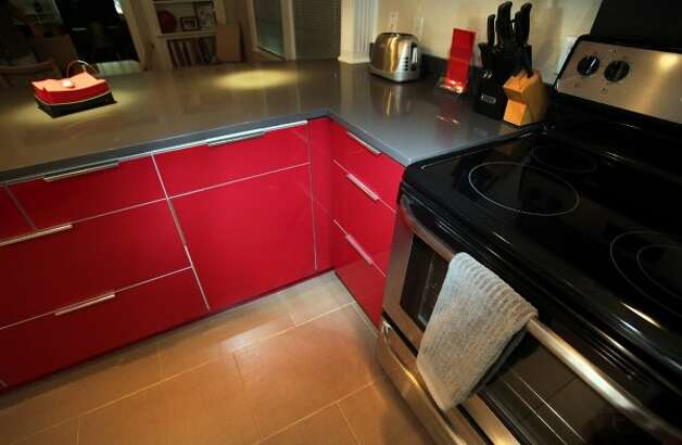 A close look at the red lacquer cabinetry in the kitchen in the home of Eric Geyer on W. Ridgewood.  Thursday, July 19, 2012. (San Antonio Express-News)