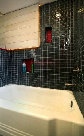 A new shower was built around the old tub in the home of Eric Geyer on W. Ridgewood.  Thursday, July 19, 2012. (San Antonio Express-News)