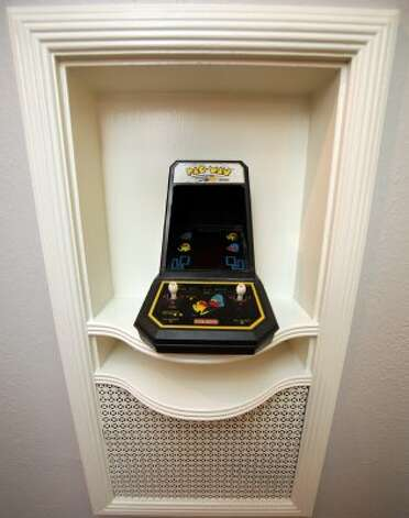 An old Pac-Man game sits in the place of the old rotary phone in the phone nook at the home of Eric Geyer on W. Ridgewood.  Thursday, July 19, 2012. (San Antonio Express-News)