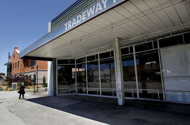 The Tradeway Furniture building, in El Cerrito, Ca., on Friday July 20, 2012, which is next door to City Hall, was to be turned into affordable senior housing with redevelopment funds, instead sits idle. The City of El Cerrito and the redevelopment Agency filed suit on June 12, 2012, against the Contra Costa county Auditor-Controller, the California Department of Finance and the california Board of Equalization, challenging a $1,756,794 payment demanded by the County auditor-controller on July 9, 2012. Photo: Michael Macor, The Chronicle