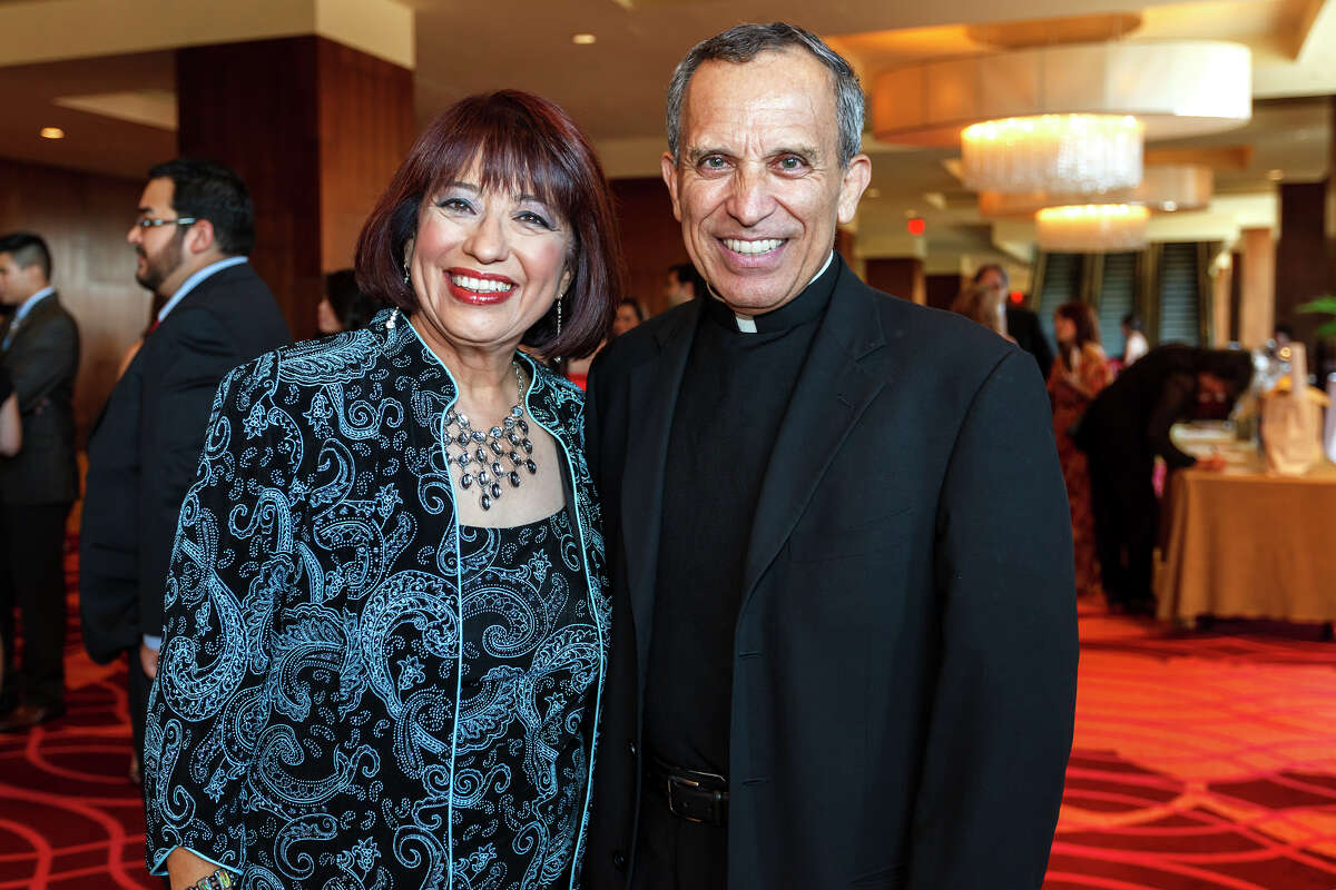 KSAT's Jessie Degollado ( left) and Father David Garcia pose for a photo during the San Antonio Associationn of Hispanic Journalists' 25th anniversary celebration at the Grand Hyatt on July 20, 2012. The event was SAAHJ's 14th annual scholarship gala. This year, in honor of its silver anniversary, it awarded $25,000 to 13 San Antonio college students pursuing careers in print and brodcast journalism as well as public relations and marketing. Degollado was honored with SAAHJ's Henry Guerra Lifetime Achievement Award for Excellence in Journalism and Father Garcia received its 2012 Community Service Award for his work in restoring San Fernando Cathedral, as its one-time rector, and for his ongoing work to renovate San Antonio's historic Spanish Colonial missions. MARVIN PFEIFFER/ mpfeiffer@express-news.net