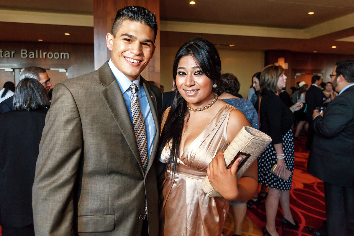 Richard Escobedo and Ana Federico pose for a photo as the San Antonio Association of Hispanic Journalists celebrated its 25th anniversary at the Grand Hyatt on July 20, 2012. The event was SAAHJ's 14th annual scholarship gala. This year, in honor of its silver anniversary, it awarded $25,000 to 13 San Antonio college students pursuing careers in print and brodcast journalism as well as public relations and marketing. Escobedo and Federico were two of the recepients of the scholarships. KSAT's Jessie Degollado was honored with SAAHJ's Henry Guerra Lifetime Achievement Award for Excellence in Journalism and Father David Garcia recived it's 2012 Community Service Award for his work in restoring San Fernando Cathedral, as its one-time rector, and for his ongoing work to renovate San Antonio's historic Spanish Colonial missions. MARVIN PFEIFFER/ mpfeiffer@express-news.net