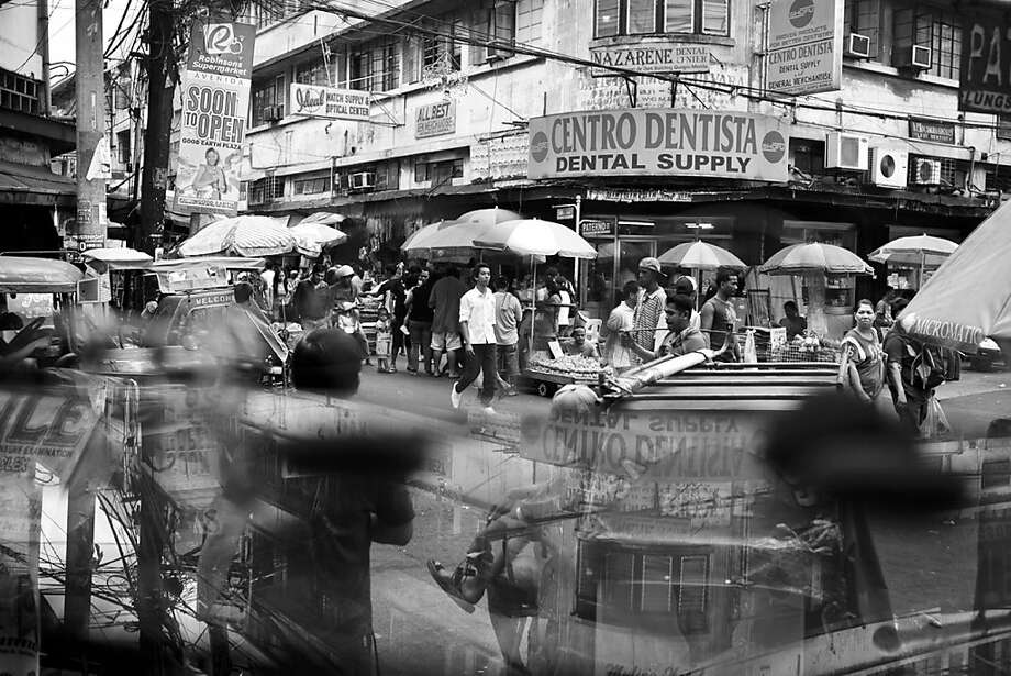 Paterno Street at the heart of Quiapo District in Manila, considered a tough neighborhood in the metropolis. Photo: Rick Rocamora