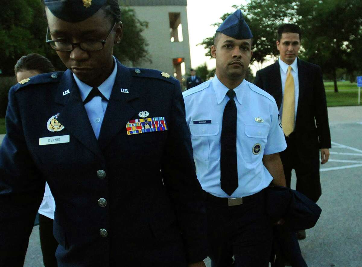 Air Force Staff Sgt. Luis Walker (second from right) and others leave his trial at Joint Base San Antonio-Lackland on July 20, 2012, after he was convicted on all counts of illicit sexual contact with 10 women in basic training.