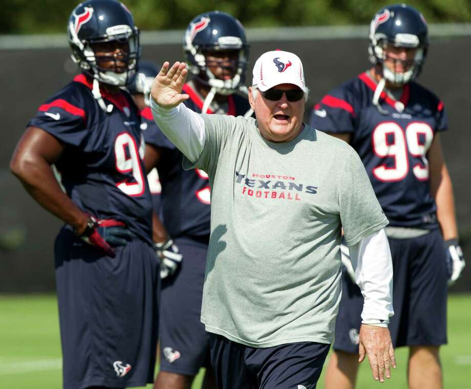 Houston Texans defensive coordinator Wade Phillips works with the Texans defense during Texans organized team activities at the Methodist Training Center Tuesday, June 5, 2012, in Houston.  ( Brett Coomer / Houston Chronicle ) Photo: Brett Coomer, Staff / © 2012 Houston Chronicle