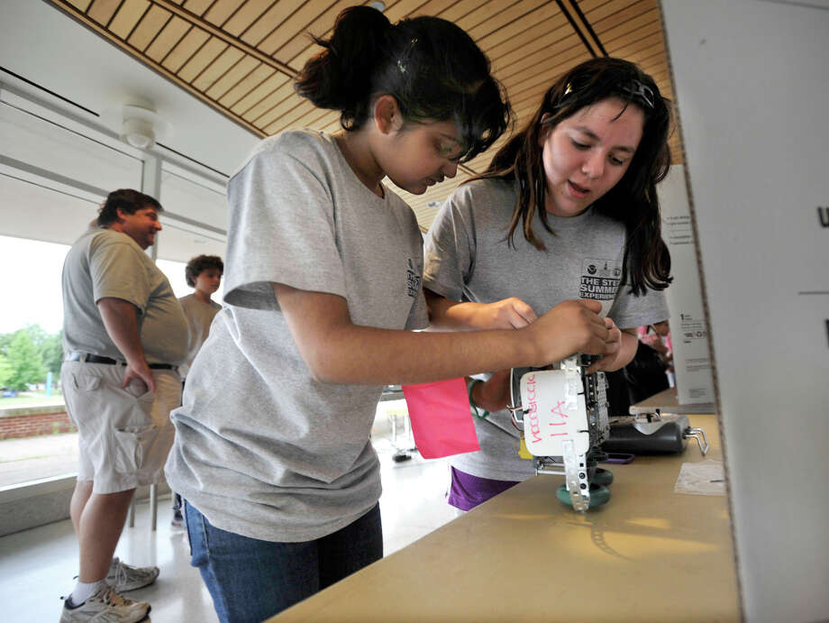 Omika Suryawanshi, 11, left, and Eliana Mollengarden, 11, work on a robotic remote-controlled car during the final day of Summer STEM Experience at Western Connecticut State University's midtown campus in Danbury on Friday, July 20, 2012. Photo: Jason Rearick / The News-Times