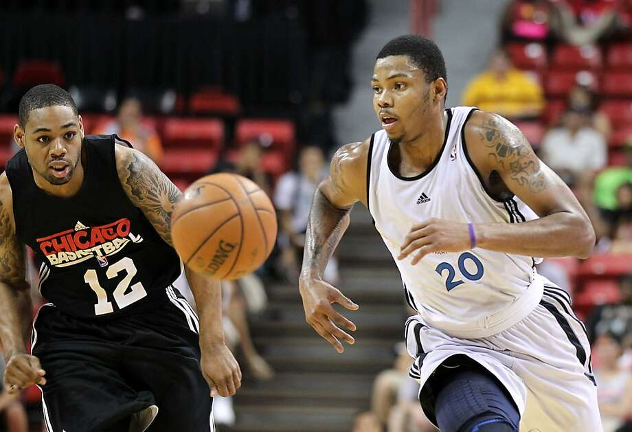 The Chicago Bulls Demetri McCamey, left, and Golden State Warriors guard Kent Bazemore go after a loose ball during an NBA Summer League basketball game on Friday, Dec. 20, 2012, in Las Vegas. (Photo by Isaac Brekken for the Chronicle) Photo: Isaac Brekken, Special To The Chronicle
