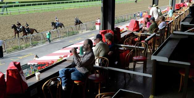 Race fans watch the morning works at the Saratoga Race Course on opening day 144 July 20, 2012.  (Skip Dickstein / Times Union)  FOR IORRIZZO STORY Photo: SKIP DICKSTEIN