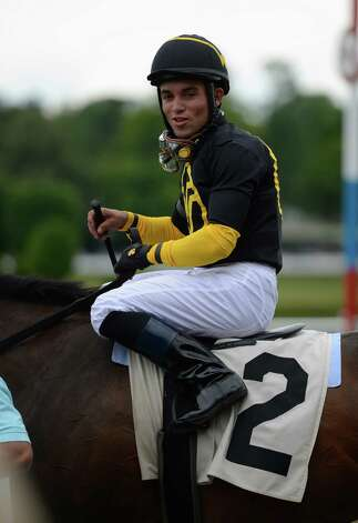 Jockey Joel Rosario heads to the winner's circle at the Saratoga Race Course on opening day 144 July 20, 2012.  (Skip Dickstein / Times Union)  FOR IORRIZZO STORY Photo: SKIP DICKSTEIN