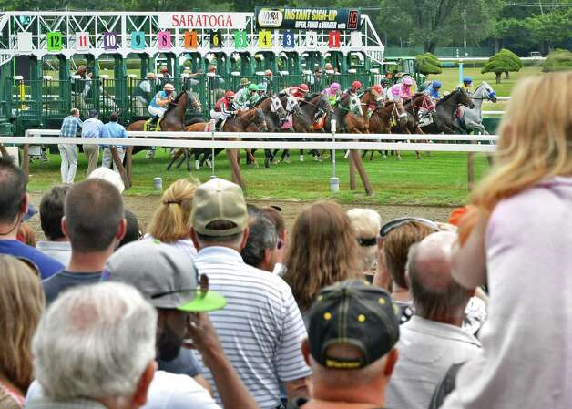 Race goers watch the start of the second race at Saratoga Race Course's opening day Friday July 20, 2012.   (John Carl D'Annibale / Times Union) Photo: John Carl D'Annibale / 00018477B