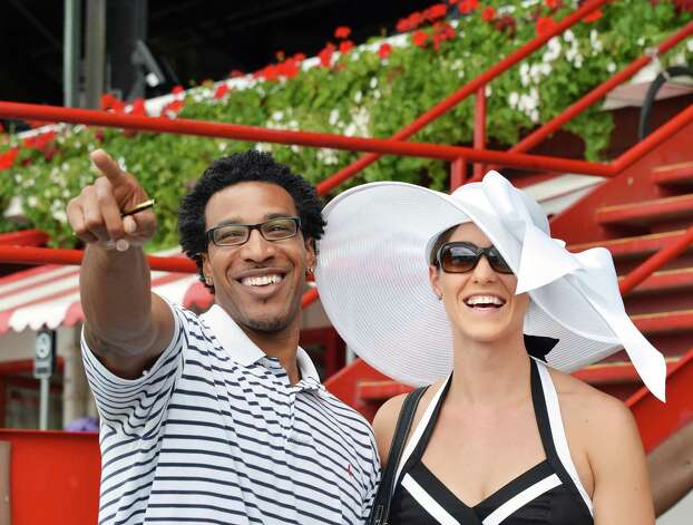 Honeymooners Shawn and Katie Tyndell of Silver Springs, Maryland at Saratoga Race Course's opening day Friday July 20, 2012.   (John Carl D'Annibale / Times Union) Photo: John Carl D'Annibale / 00018477B