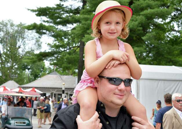 Five-year-old Abby Rose Schutz rides on her father's, James Schutz of Geneva,NY, shoulders during Saratoga Race Course's opening day Friday July 20, 2012.   (John Carl D'Annibale / Times Union) Photo: John Carl D'Annibale / 00018477B