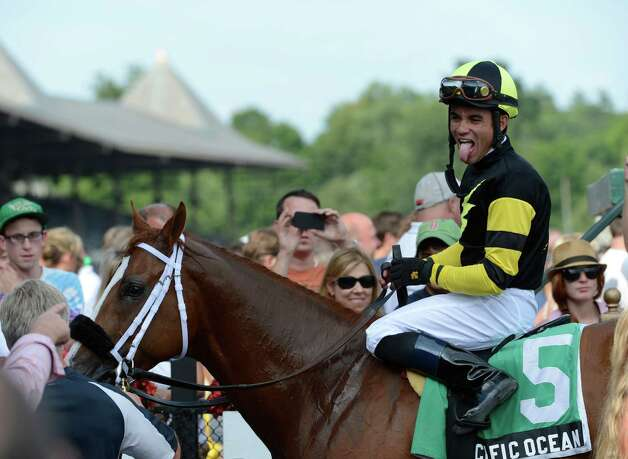 Jockey Joel Rosario sticks his tongue out in the winner's circle after winning the 5th running of The James Marvin stake at the Saratoga Race Course on opening day 144 July 20, 2012.  (Skip Dickstein / Times Union)  FOR IORRIZZO STORY Photo: SKIP DICKSTEIN