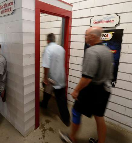 Men go in to the Gentleman's restroom on the first floor of the Saratoga Race Course which was hampered by lack of water on opening day 144 July 20, 2012.  (Skip Dickstein / Times Union)  FOR IORRIZZO STORY Photo: SKIP DICKSTEIN