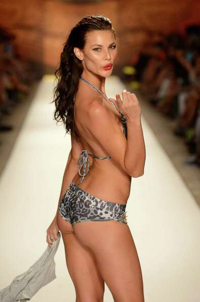 A model walks the runway at the Agua Bendita show.