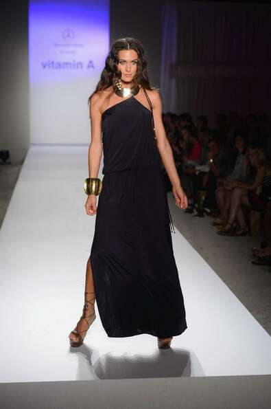 A model walks the runway at the Vitamin A by Amahlia Stevens show.