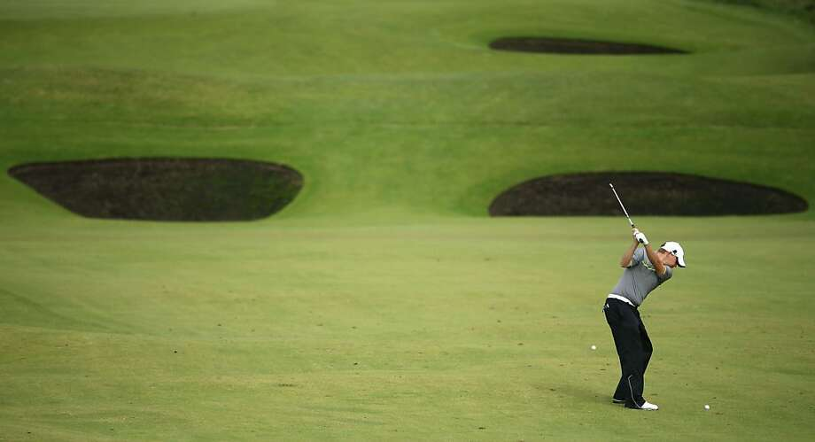 LYTHAM ST ANNES, ENGLAND - JULY 20:  James Morrison of England hits a shot on the eighth hole during the second round of the 141st Open Championship at Royal Lytham & St Annes Golf Club on July 20, 2012 in Lytham St Annes, England.  (Photo by Andrew Redington/Getty Images) Photo: Andrew Redington, Getty Images