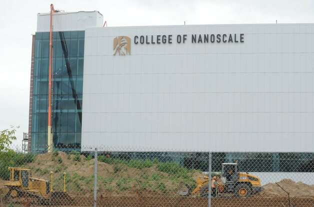 New signage on the recently built building of UAlbany College of Nanoscale in Albany NY Friday July 20, 2012. (Michael P. Farrell/Times Union) Photo: Michael P. Farrell