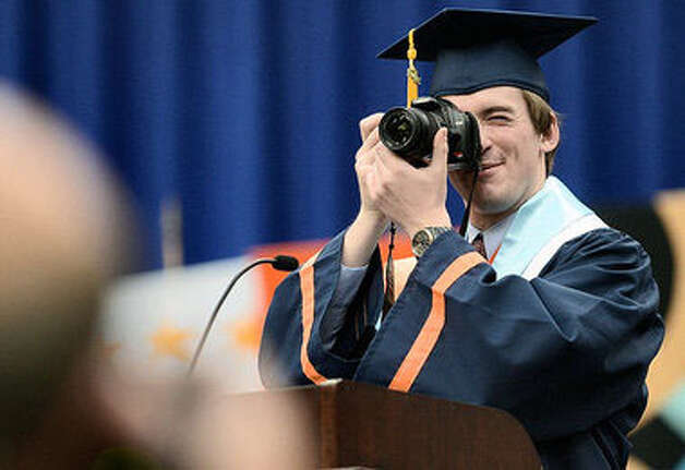 In this file photo from The Post-Standard, Syracuse University Scholar Stephen Barton of the Colleges of Arts and Sciences takes a photo as he addresses the Syracuse University 158th Commencement. Photo credit: Stephen D. Cannerelli/ The Post-Standard Photo: Contributed Photo
