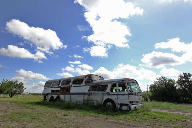"A worn-out bus sits on the property that was known as the unincorporated town of Bankersmith, Texas on Thursday, July 19, 2012. Bikinis restauranteur Doug Guller purchased the town earlier this week. Guller, in a press release, said he would rename the town to Bikinis, Texas. Guller also expressed a desire to turn the 1.6-acre strip of land into a ""world class destination"" with an event set for the fall. The town is approximately 10 miles south of Fredericksburg, Texas. Photo: Kin Man Hui, SAN ANTONIO EXPRESS-NEWS / ©2012 San Antonio Express-News"