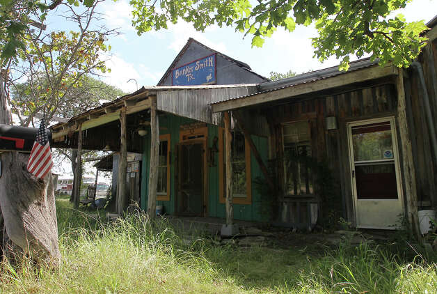 "The former post office and general store for Bankersmith, Texas sits vacated on Thursday, July 19, 2012 after Bikinis restauranteur Doug Guller purchased the unincorporated town earlier this week. Guller, in a press release, said he will rename the town to Bikinis, Texas. Guller also expressed a desire to turn the 1.6-acre strip of land into a ""world class destination"" with an event set for the fall. The town is approximately 10 miles south of Fredericksburg, Texas. Photo: Kin Man Hui, SAN ANTONIO EXPRESS-NEWS / ©2012 San Antonio Express-News"