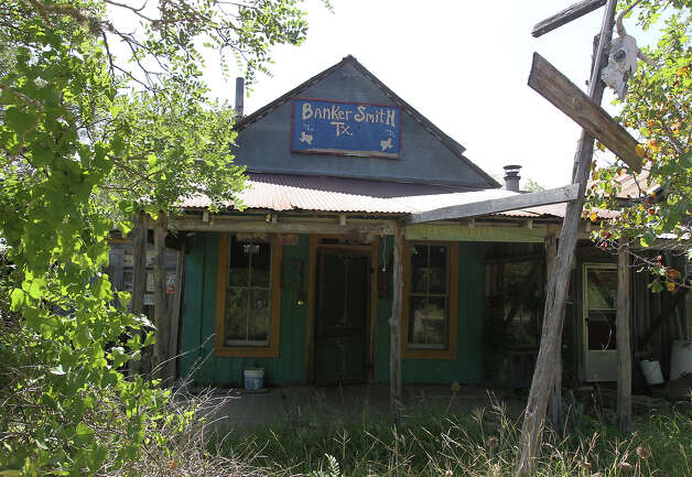 "The former post office and general store for Bankersmith, Texas sits vacated on Thursday, July 19, 2012 after Bikinis restauranteur Doug Guller purchased the unincorporated town earlier this week. Guller, in a press release, said he would rename the town to Bikinis, Texas. Guller also expressed a desire to turn the 1.6-acre strip of land into a ""world class destination"" with an event set for the fall. The town is approximately 10 miles south of Fredericksburg, Texas. Photo: Kin Man Hui, SAN ANTONIO EXPRESS-NEWS / ©2012 San Antonio Express-News"