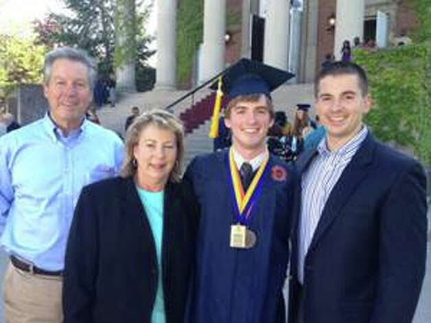 Stephen Barton is photographed with his family in May at his graduation from Syracuse University. From left are Stephen's parents, Carl and Christine Barton, Stephen, a Fulbright Scholar and Syracuse student commencement speaker, and brother, David. Photo courtesy of the Barton family Photo: Contributed Photo