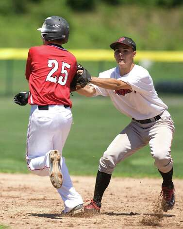 Pomperaug second baseman Nick Sarno tags out Norwalk's Matt Diurno and then fires to first to complete the double play in the Babe Ruth 14-year-old championship game Saturday at Newtown High School. Photo: Barry Horn / The News-Times Freelance