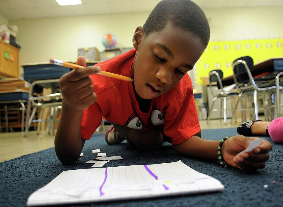 Drevon Kearney sorts rhyming words during summer school classes at Stillmeadow Elementary School on Tuesday, July 10, 2012. Photo: Lindsay Niegelberg / Stamford Advocate